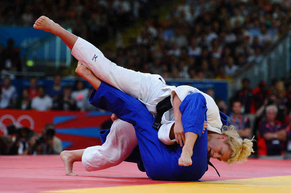 Kayla Harrison of the United States (in white) and Gemma Gibbons of Great Britain compete in the women's 78 kg judo.