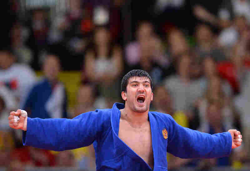 Russia's Tagir Khaibulaev celebrates after winning the men's 100kg judo contest final match.