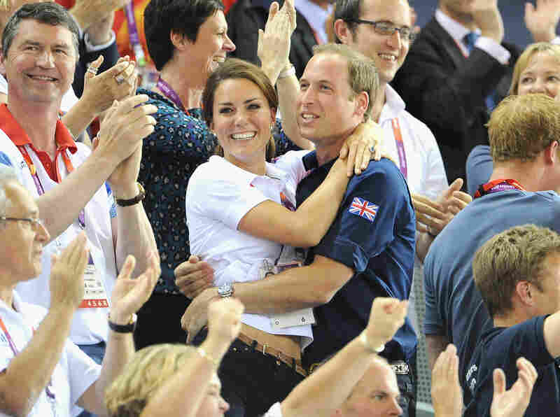 Kate Middleton and Prince William celebrate after Great Britain's performance in the cycling event.
