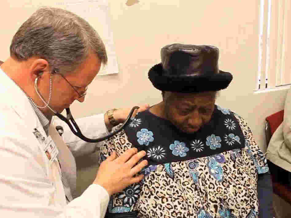 Dr. David Gilder gives Sally Johnson a checkup at the Mallory Community Health Center in Tchula, Miss.