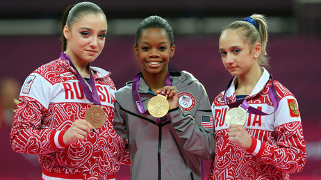 Who's The Happiest? Researchers studied photos of Olympic medalists to learn who is the happiest. Here, bronze medalist Aliya Mustafina of Russia, gold medalist Gabby Douglas of the U.S., and silver medalist Victoria Komova of Russia pose after the all-around gymnastics final.