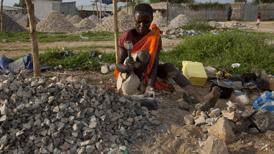 A woman pounds rocks for a few dollars a day in Juba, South Sudan. (Getty Images)