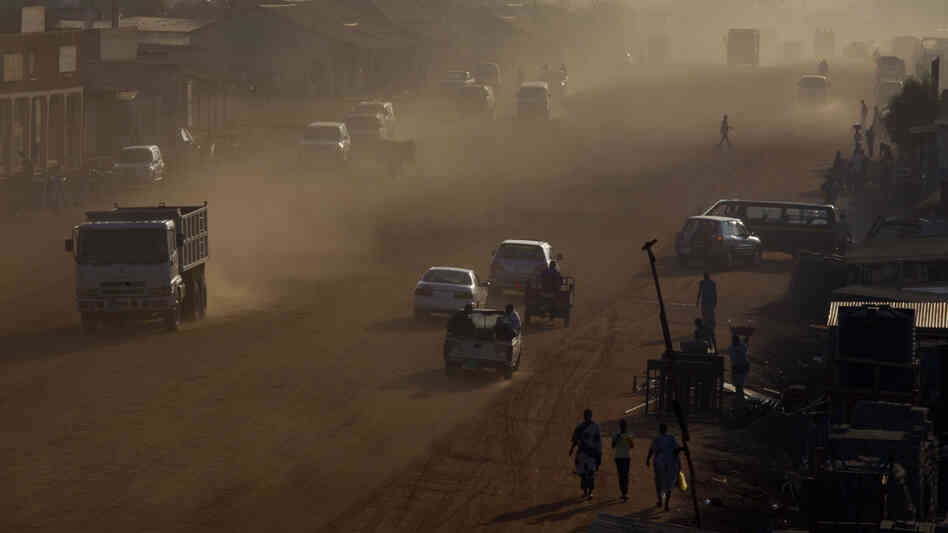 Traffic moves along a major road under construction in Juba, South Sudan's capital, on July 19, shortly after the country celebrated its first anniversary of independence from Sudan. Corruption scandals have plagued the impoverished new nation over the past year.
