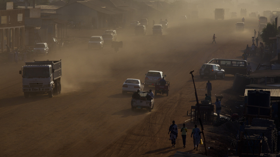 Traffic moves along a major road under construction in Juba, South Sudan's capital, on July 19, shortly after the country celebrated its first anniversary of independence from Sudan. Corruption scandals have plagued the impoverished new nation over the past year. (Getty Images)