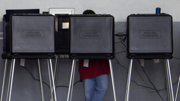 A voter casts his ballot in a West Miami, Fla., fire station during the Republican primary in January. (AP)