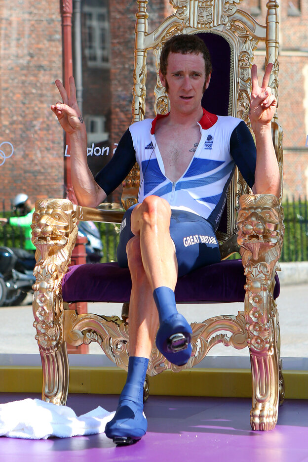 "The Mods' New King? Cyclist Bradley Wiggins sits on a chair that looks an awful lot like a throne, after winning an Olympic gold medal Wednesday. Hailed in Britain for his mod tastes and funny tweets, Wiggins celebrated his win by getting ""blind drunk,"" he said."