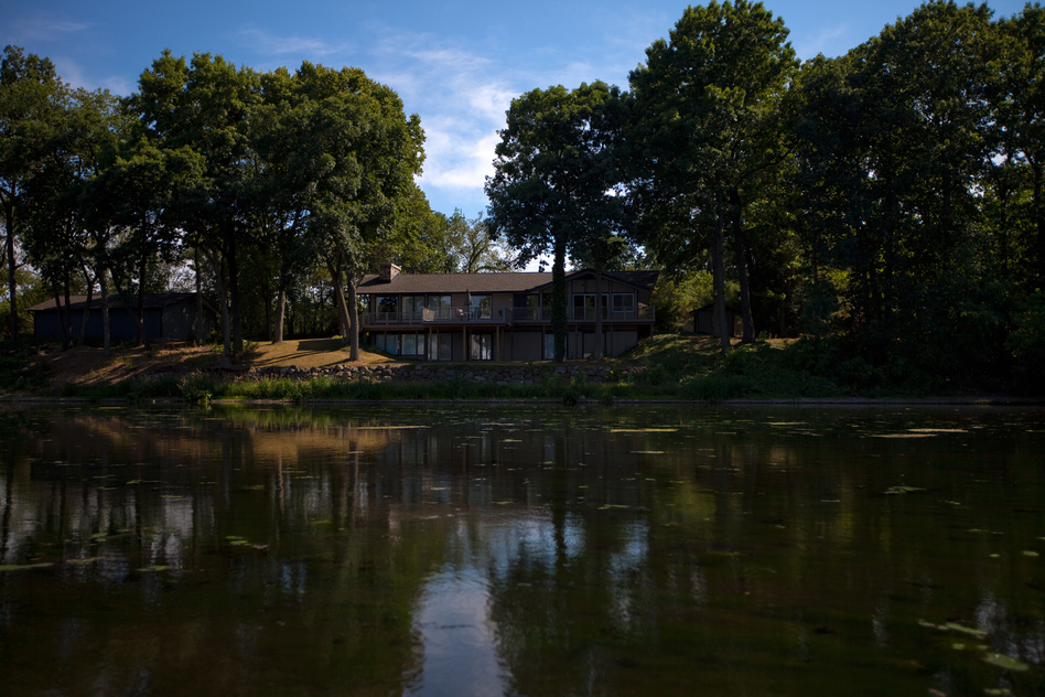One of dozens of houses along the Kalamazoo River sits empty since the spill. Enbridge offered to buy up most of the property along the river immediately after the spill, and most residents sold at deflated prices to escape the area. (NPR)