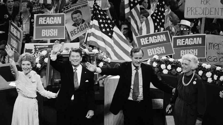 GOP presidential candidate Ronald Reagan, his running mate, George Bush, and their wives, Nancy Reagan and Barbara Bush, wave from the podium at the 1980 Republican National Convention in Detroit on July 17. In picking Bush, Reagan created a ticket that unified the party.
