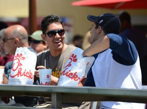 Two men prepare to have lunch on the patio of the Chick-fil-A in Hollywood, Calif. on August 1. Thousands of Americans turned out Wednesday to feast on fried chicken in a politically-charged show of support for a family owned fast food chain which opposes gay marriage.