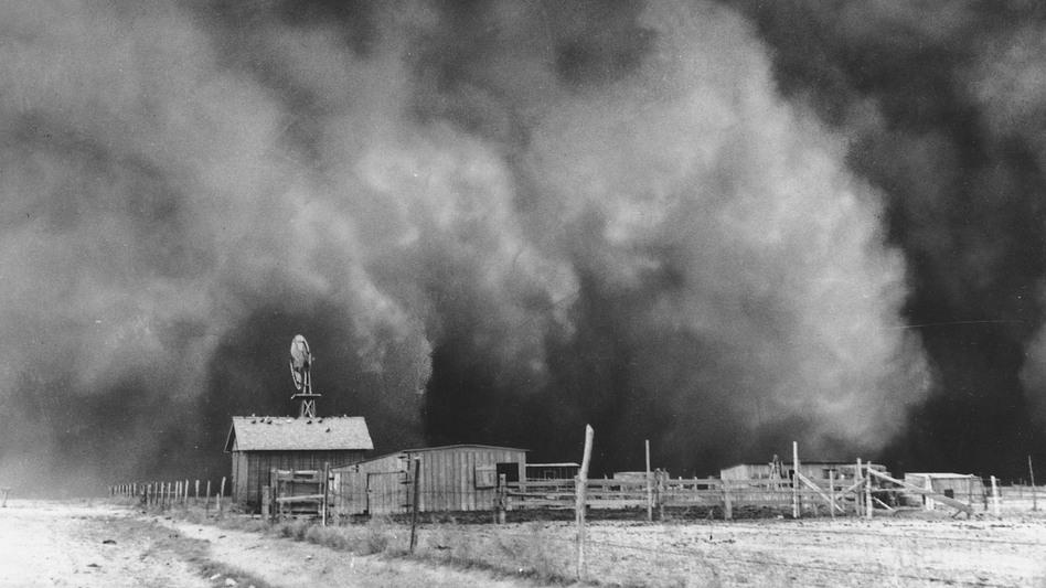 A gigantic dust cloud engulfs a ranch in Boise City, Okla., in 1935. (AP)