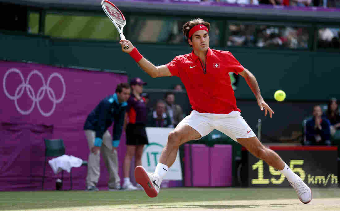 Roger Federer of Switzerland returns a shot against Juan Martin Del Potro of Argentina in their Olympic semifinal played at Wimbledon. Federer won the match, which took more than 4 hours to play.