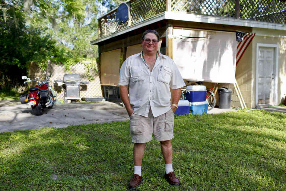 Gregory Brown, 52, used to be a glazier installing plate-glass windows. He now lives off of unemployment checks, plus the disability checks of a woman who lives with him in Lutz, Fla. Brown is selling his motorcycle to help pay the bills. He is eager to vote President Obama out this fall, and says he plans to register to vote before the election.
