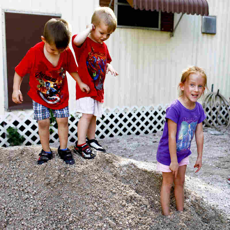 Katrina Bordwell's home was flooded recently after nearby development stopped up a drainage pipe. Bordwell, 24, lives in the community with her children, from left, Leo, 3, her boyfriend's son Kyle Cose, 3, and Zoey, 5.