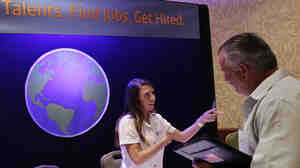 A job recruiter talks with an unemployed man, at a job fair in San Jose, Calif., last week. The Labor Department reported Friday that employers added 163,000 net jobs last month but the unemployment rate rose to 8.3 percent.