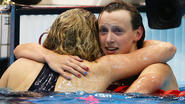 American Katie Ledecky seemed to be in disbelief as she hugged bronze medalist Rebecca Adlington of Great Britain. Ledecky, 15, won the women's 800m freestyle by four seconds in London. (Getty Images)