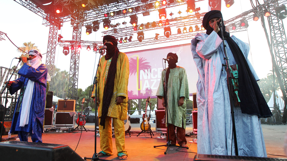 A Tuareg band from Mali, Tinariwen, performs in Nice, France, in July. The band has developed an international reputation and won a Grammy this year. See them perform at NPR headquarters. (AFP/Getty Images)