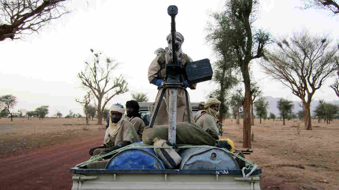 Militiaman from the Ansar Dine radical Islamic group ride on an armed vehicle between Gao and Kidal in northeastern Mali in June. Jihadists currently control the country's north.