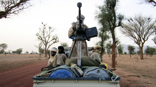 Militiaman from the Ansar Dine radical Islamic group ride on an armed vehicle between Gao and Kidal in northeastern Mali in June. Jihadists currently control the country's north. (Reuters/Landov)