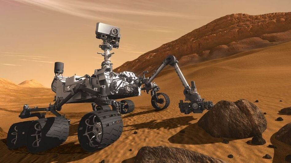 Mmm, nice rock! This rover's looking for secrets to the history of life on Mars. (Photo Illustration Courtesy NASA)
