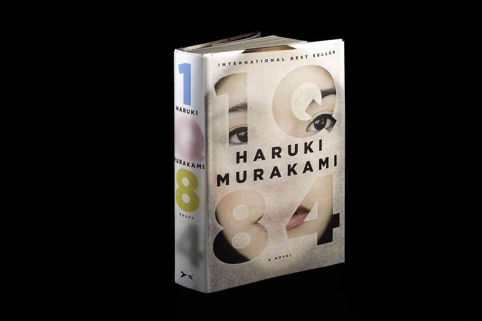 "1Q84 by Haruki Murakami: ""This epic, complex story begins when a woman named Aomame in 1984 Tokyo has a revelation that she has entered a universe parallel to our own. She calls it 'Q' for question, and in Japanese, Q rhymes with 9. I wanted to represent these two planes of existence with the book's jacket and its paper binding underneath."""