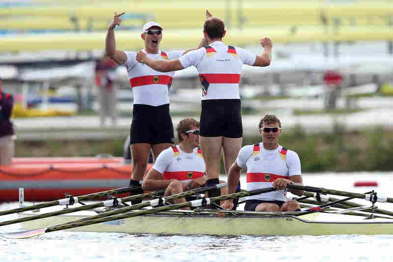 Karl Schulze, Phillipp Wende, Lauritz Schoof and Tim Grohmann of Germany celebrate winning gold in the men's quadruple sculls final.