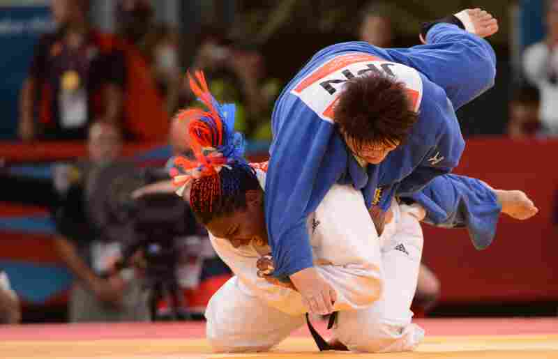 Cuba's Idalys Ortiz (in white) tosses Japan's Mika Sugimoto during the women's 78kg judo contest match. Ortiz won the match.