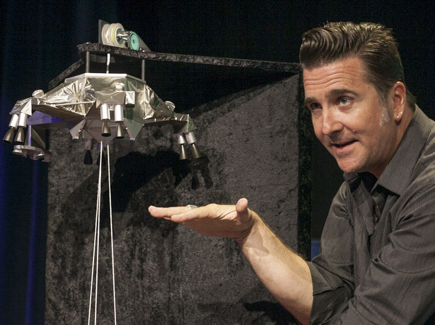 Adam Steltzner led the NASA team that dreamed up a new way to land on Mars. He's seen here at JPL on Aug. 2 using a scale model to explain how the rover Curiosity will land on the red planet.