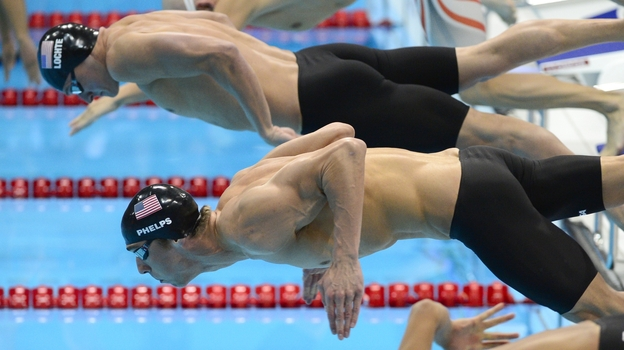 Swimmers Michael Phelps and Ryan Lochte deploy their muscles to win medals for the United States at the 2012 London Olympic Games. (AFP/Getty Images)