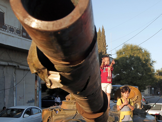 In Aleppo, Syria, on Thursday: Children climb on an abandoned Syrian army tank. (AFP/Getty Images)