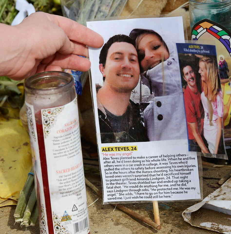 In Aurora, Colo., last week, among the memorials to victims of the shooting was one for Alex Teves. It includes a photo of him with girlfriend Amanda Lindgren. Teves protected her with his body.