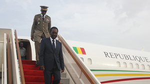 Mali's interim president, Dioncounda Traore, disembarks from a plane at Bamako airport last month. Traore returned to Bamako amid tight security following a two-month stay in Paris for medical treatment after being savagely beaten in the aftermath of the country's coup.