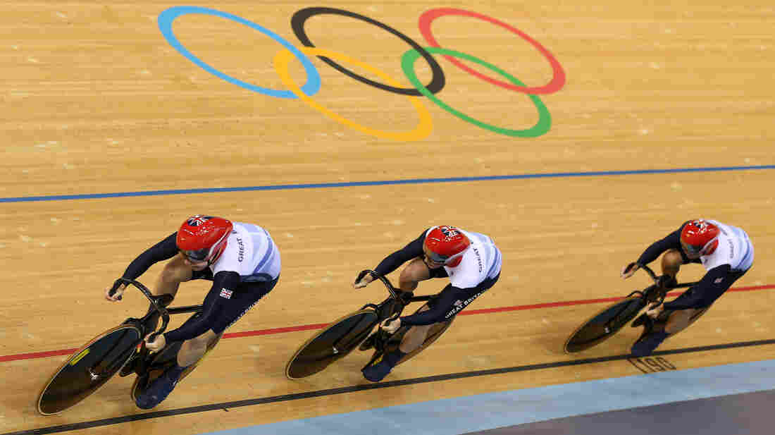 The British sprint team of Philip Hindes (front), Jason Kenny and Sir Chris Hoy won a gold medal Thursday, but remarks by Hindes caused concerns about athletes' ethics to resurface. The IOC says it will not investigate.