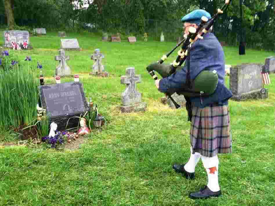 Bagpipe player Dave Olson makes visiting the grave part of his regular routine.