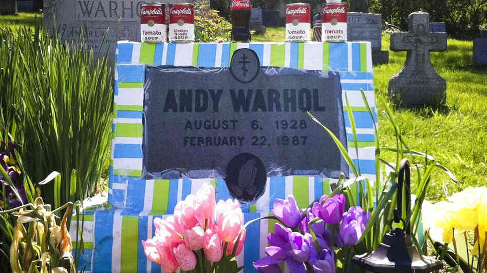 Fans leave all manner of mementos at Andy Warhol's grave site, near Pittsburgh. This spring, a local Warhol impersonator wrapped the grave stone in colorful paper for an entire month.
