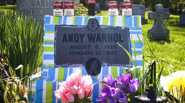 Fans leave all manner of mementos at Andy Warhol's grave site, near Pittsburgh. This spring, a local Warhol impersonator wrapped the grave stone in colorful paper for an entire month. (Madelyn Roehrig)