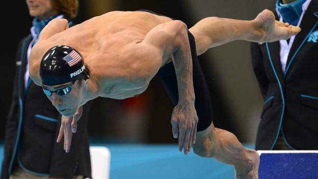 One more time: American swimmer Michael Phelps dives in to swim the butterfly leg of the men's medley relay Saturday. Phelps' team won the Olympic gold medal, giving him 22 overall and 18 gold when he leaves the London Games. (AFP/Getty Images)