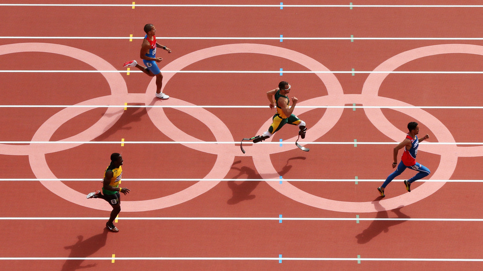 Oscar Pistorius of South Africa, center, became the first amputee to run in the Olympics. He came in second to Luguelin Santos of the Dominican Republic, to advance to the men's 400m semifinals. (Getty Images)