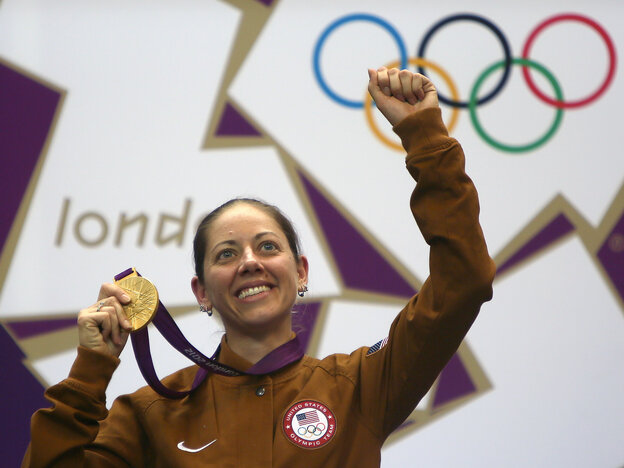 American gold medalist Jamie Lynn Gray celebrates on the podium after