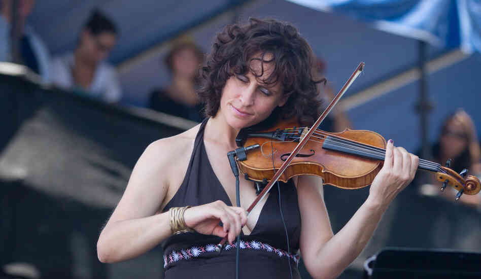 Violinist Jenny Scheinman performs with Bill Frisell at the 2012 Newport Jazz Festival.