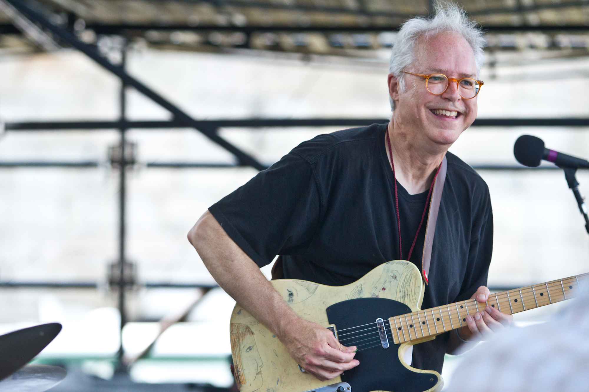 Guitarist Bill Frisell was all smiles during his set of John Lennon interpretations.