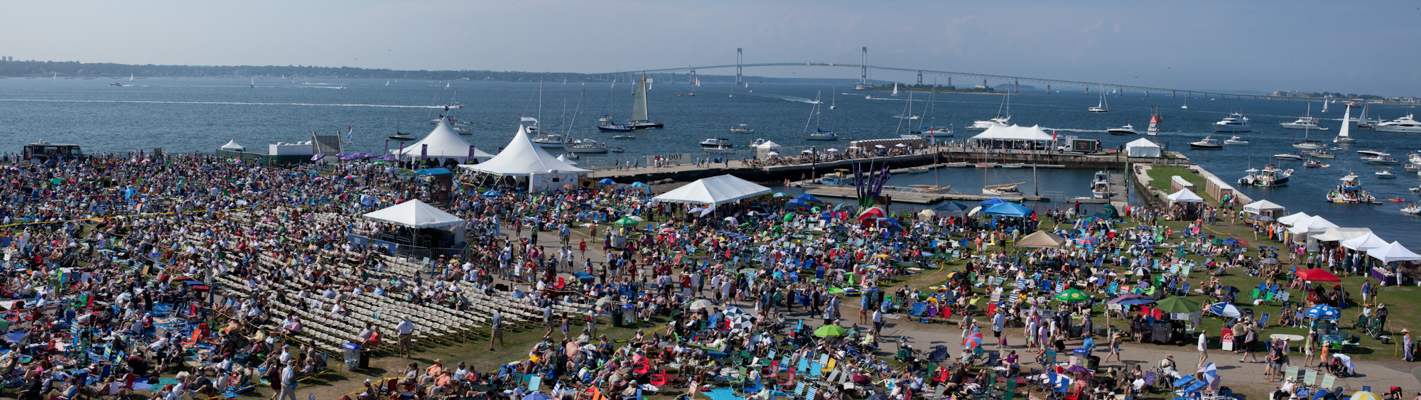 Concert goers take in the Narragansett Bay at Fort Adams State Park during the Newport Jazz Festival.