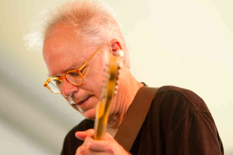 Guitarist Bill Frisell performs with The Bad Plus at the 2012 Newport Jazz Festival.