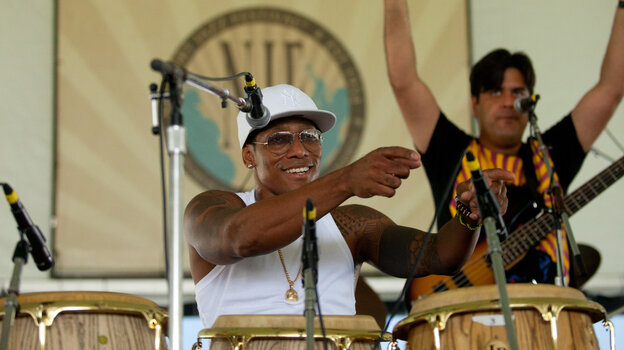 Vocalist and conguero Pedrito Martinez (center) performs with bassist Alvaro Benavides (right) at the 2012 Newport Jazz Festival.