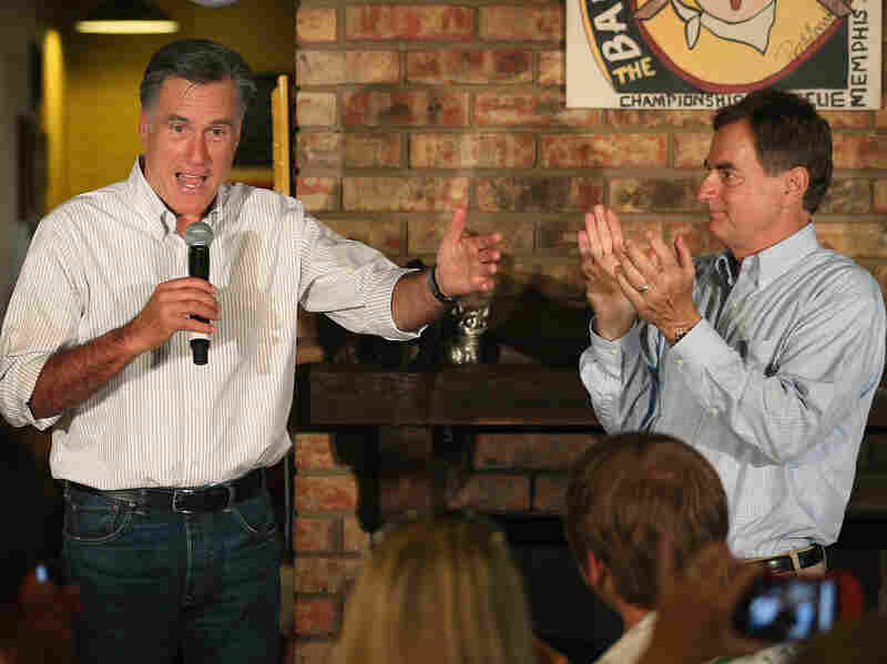 U.S. Senate candidate Richard Mourdock, right, applauds as Republican presidential candidate Mitt Romney speaks during a campaign event at Stepto's Bar-B-Q Shack in Evansville, Ind., Saturday.
