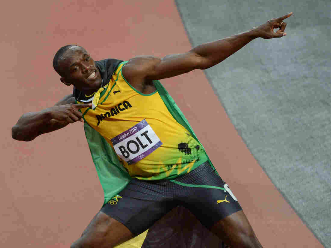 Jamaica's Usain Bolt celebrates after winning the men's 100m final at the London Games on Sunday.