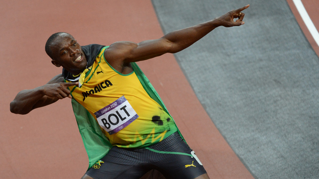Jamaica's Usain Bolt celebrates after winning the men's 100m final at the London Games on Sunday. (AFP/Getty Images)