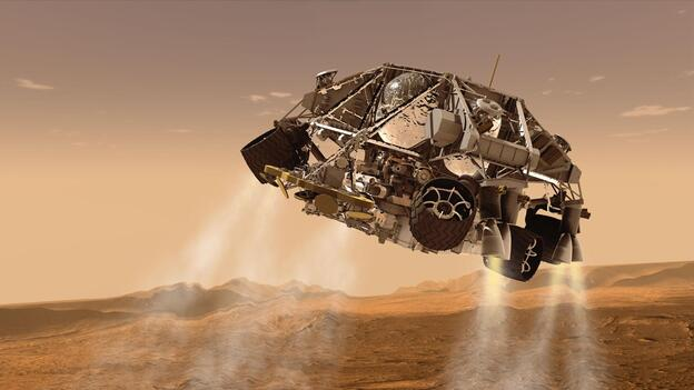 An artist's concept of NASA's Mars Science Laboratory spacecraft depicts the final minute before the rover, Curiosity, touches down on the surface of Mars. (NASA/JPL-Caltech)