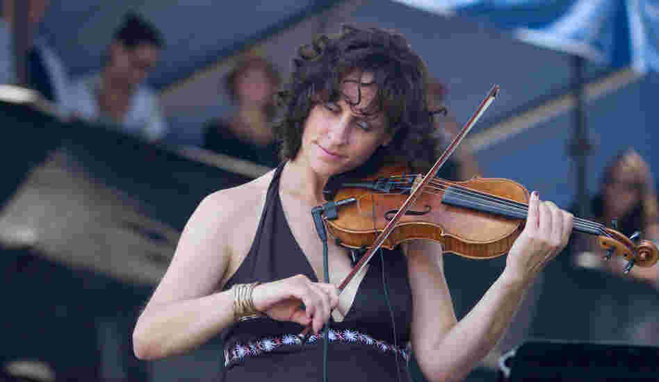 Violinist Jenny Scheinman performs with guitarist Bill Frisell's John Lennon tribute project on the Fort Stage. The following day, she and Frisell would also perform as a fiddle-and-guitar duo.