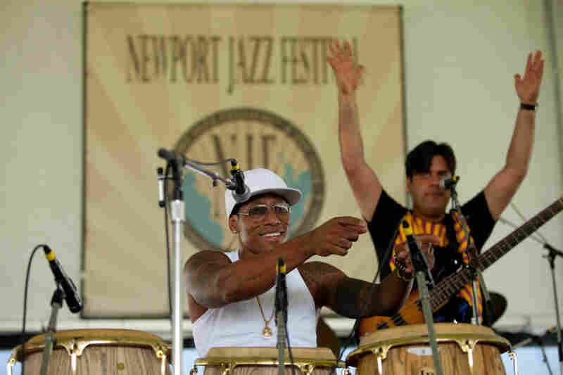 Before noon Saturday, the quartet led by charismatic conguero Pedrito Martinez had its audience gyrating to Afro-Cuban rhythms. Bassist Alfaro Benavides provides additional encouragement from the stage.