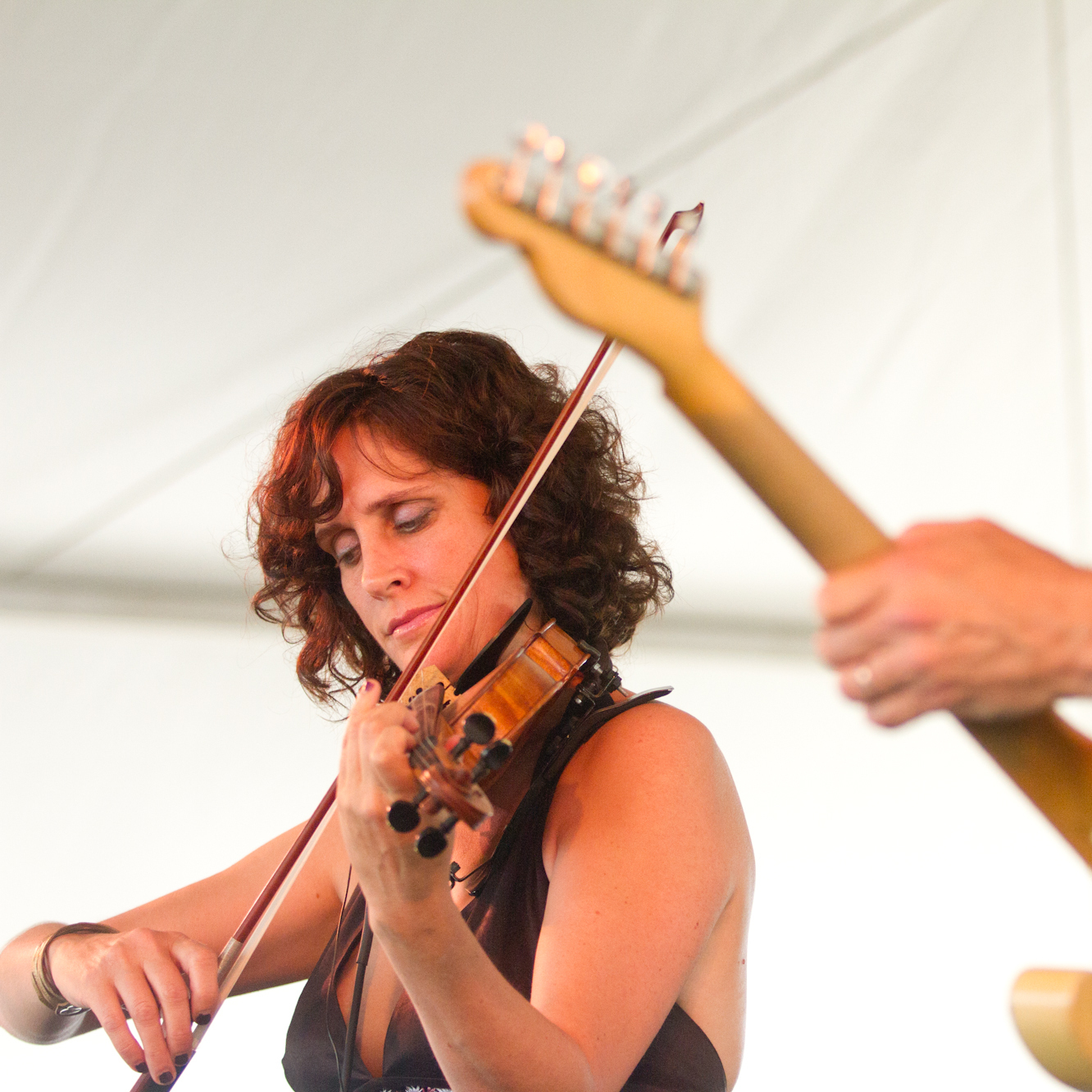 Violinist Jenny Scheinman and guitarist Bill Frisell perform at the 2012 Newport Jazz Festival.